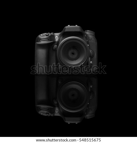 Dslr Camera On A Black Surface With Reflection