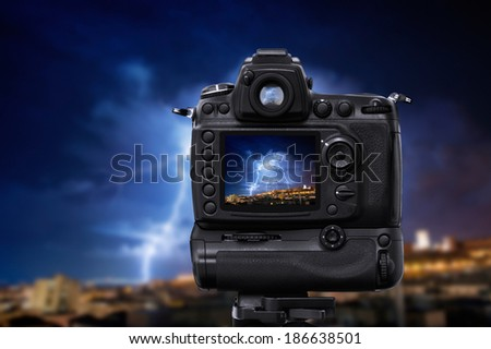 DSLR camera under a lightning storm - stock photo