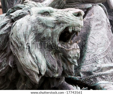 DSLR picture of a bronze sculpted head of a lion roaring, the symbol of Venice, Italy, in horizontal orientation