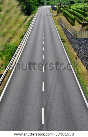 dual carriageway with white stripes and black asphalt