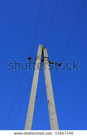 Dual electrical columns  on blue sky background