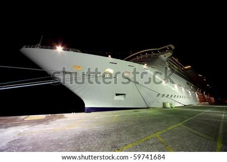 DUBAI - APRIL 19: A cruise liner docks at Port Rashid on April 19, 2010 in Dubai, UAE. Port Rashid can accept 120 cruise ships in a year. - stock photo