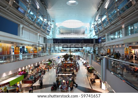 DUBAI - APRIL 19: A general view of a shopping center in Dubai International Airport on April 19, 2010 in Dubai, UAE. The maximum throughput of the airport is 80 million passengers in a year. - stock photo