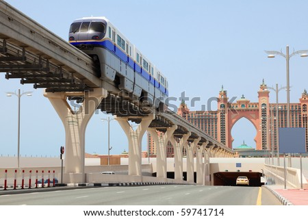 DUBAI - APRIL 19: Atlantis hotel and monorail train on a man-made island Palm Jumeirah on April 19, 2010 in Dubai, UAE. This monorail is the longest completely automated rail system in the world.