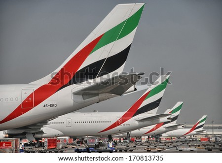 DUBAI - AUG 7: Emirates Airplane in the Dubai airport, UAE, August 7, 2009. Emirates is rated as a top 10 best airline in the world flying on youngest fleet. - stock photo