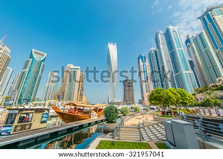 Dubai - AUGUST 9, 2014: Dubai Marina district on August 9 in UAE. Dubai is fastly developing city in Middle East - stock photo