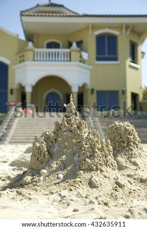 Dubai beach sand castle - stock photo