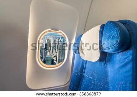 Dubai buildings as seen from airplane window. Tourism concept.