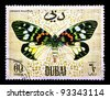 DUBAI - CIRCA 1968: A stamp printed by Dubai, shows Erasmia Pulchella, Circa 1968 - stock photo