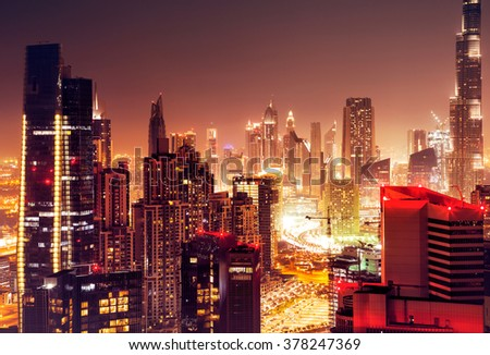 Dubai city at night, beautiful nighttime cityscape, modern tall skyscrapers glowing with many lights, luxury buildings in UAE - stock photo