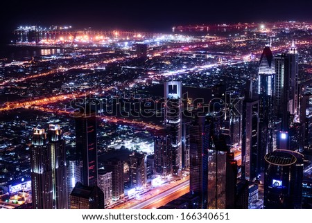 Dubai city at night, UAE, beautiful bird eye view on glowing downtown, panoramic cityscape, luxury Arabic buildings, travel and tourism concept - stock photo