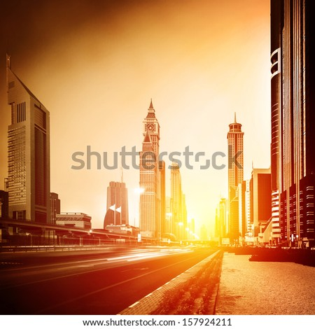 Dubai city in sunset, bright yellow sun light, beautiful panorama of modern architecture, financial center, luxury district, business city concept - stock photo