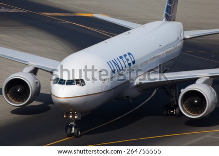 DUBAI - DECEMBER 14: An American airline, United, B777 plane is taxiing to the gate after her arrival at the Dubai International Airport as seen on December 14, 2013. - stock photo