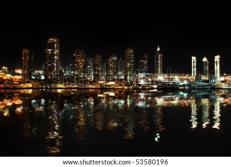 Dubai downtown at night reflected in water - stock photo