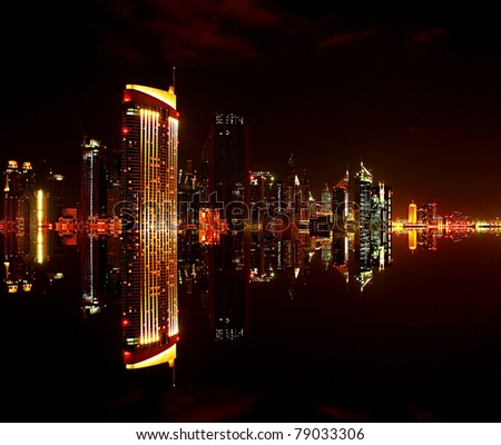 Dubai downtown at night with reflection in water, modern design of new city - stock photo