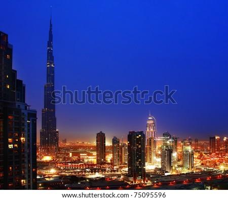 Dubai downtown night scene with city lights - stock photo