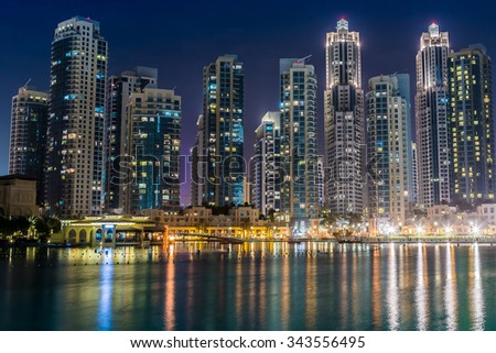 Dubai downtown night scene with city lights, luxury new high tech town in middle East. Dubai, UAE. - stock photo