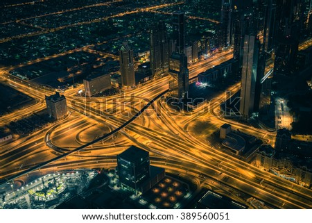 Dubai downtown night scene with city lights. Top view from above - stock photo