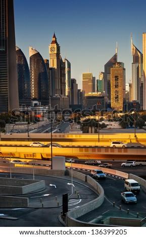 Dubai downtown skyline lit in golden evening light. - stock photo