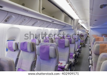 DUBAI, EMIRATES - MARCH 14, 2016:  Boeing 777 EMIRATES, Interior Economy class with TV Touch screen in Emirates Airlines in Dubai Airport. - stock photo