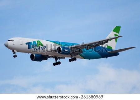 DUBAI - FEBRUARY 8: A cargo plane is seen here landing on Dubai international airport on February 8, 2013. - stock photo