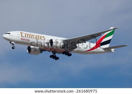 DUBAI - FEBRUARY 8: An Emirates cargo plane is seen here landing on Dubai international airport on February 8, 2013. - stock photo