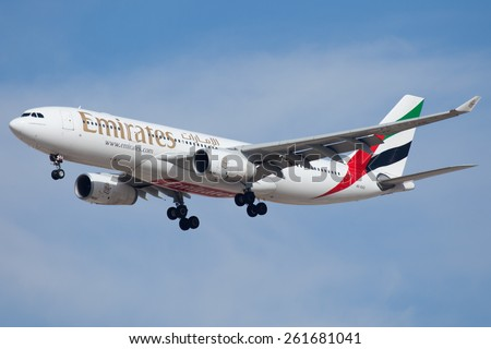 DUBAI - FEBRUARY 8: An Emirates plane is seen here landing on Dubai international airport on February 8, 2013. - stock photo