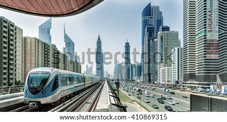 DUBAI FINANCIAL CENTER,UNITED ARAB EMIRATES-FEBRUARY 25, 2016: Financial Center and metro railway in luxury Dubai,United Arab Emirates