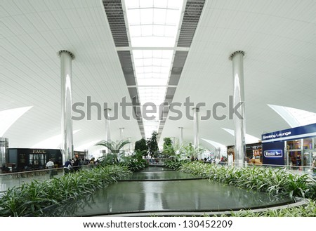 DUBAI INTERNATIONAL AIRPORT, DUBAI-AUGUST 25: A beautiful artificial garden inside Dubai International Airport on  August 25, 2012. Dubai International Airport is one of the fastest growing major hubs - stock photo