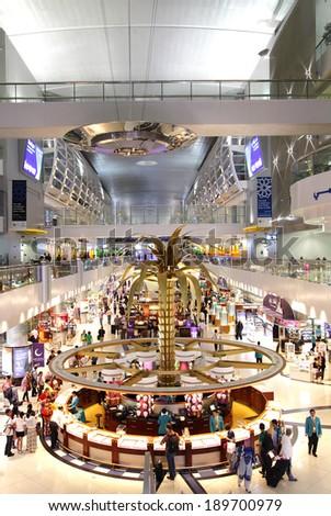 DUBAI INTERNATIONAL AIRPORT, DUBAI-JULY 25: Dubai International Airport with glorious duty free section on July 25, 2013. Dubai International is one of the fastest growing major hubs - stock photo
