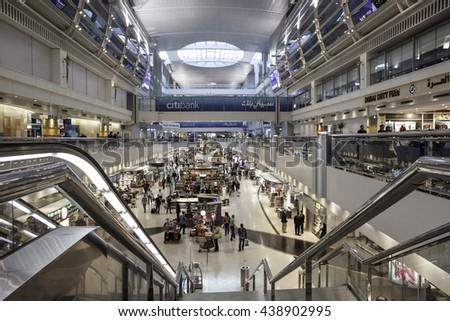 DUBAI INTERNATIONAL AIRPORT, DUBAI-OCTOBER 27: Dubai International Airport with glorious duty free section on October 27, 2013. Dubai International is one of the fastest growing major hubs - stock photo