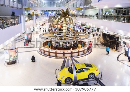 DUBAI INTERNATIONAL AIRPORT 9 March 2015. Dubai International Airport info center. Dubai is one of the fastest growing major hubs - stock photo