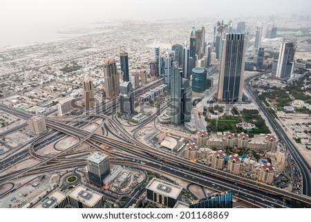 Dubai International Financial Center. Aerial view from 124th floor. - stock photo