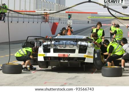 DUBAI - JANUARY 13: Car 30, a Lamborghini Gallardo LP600 during pit stop during the 2012 Dunlop 24 Hour Race at Dubai Autodrome on January 13, 2012. - stock photo