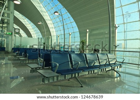 DUBAI - JANUARY 06: Waiting area in International airport on January 6, 2013 in Dubai, UAE. The airport is major aviation hub in the Middle East with max throughput of 80 millions passengers per year - stock photo