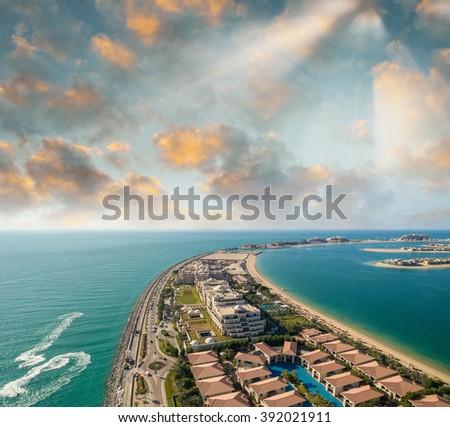 Dubai Jumeirah Island at dusk - stock photo