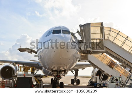DUBAI - JUNE 02: Airbus a340 loaded in International airport on June 2, 2012 in Dubai, UAE. The airport is major aviation hub in the Middle East with max throughput of 80 millions passengers per year