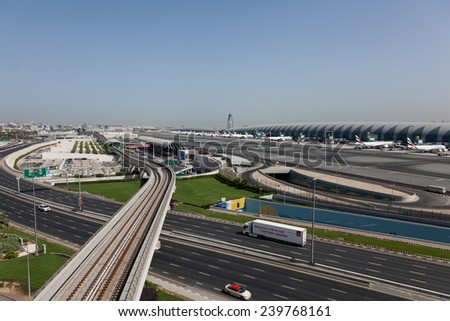 DUBAI - JUNE 20: An overview of Dubai Internation Airport termonal and ramp as seen on June 20, 2014. Dubai International Airport is one of the largest passenger hubs in middle east. - stock photo