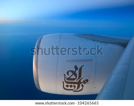 DUBAI - JUNE 2: Boeing 777 Emirates on flight to Moscow, June 2, 2012. Emirates is rated as a top 10 best airline in the world flying on youngest fleet - stock photo