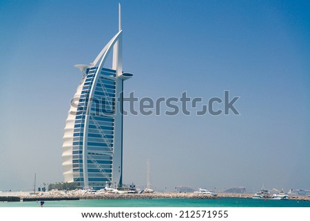 DUBAI - JUNE 10, 2014 - Burj Al Arab hotel on June 10, 2014 in Dubai. Burj Al Arab is a luxury 7 star hotel in Dubai - stock photo