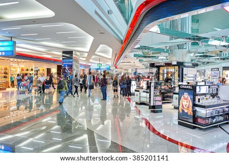 DUBAI - JUNE 23, 2015: Dubai duty-free at Dubai International Airport. Dubai International Airport is the primary airport serving Dubai, United Arab Emirates - stock photo