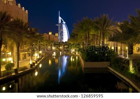 Dubai landmark - seven star luxury hotel Burj Al Arab by night - stock photo
