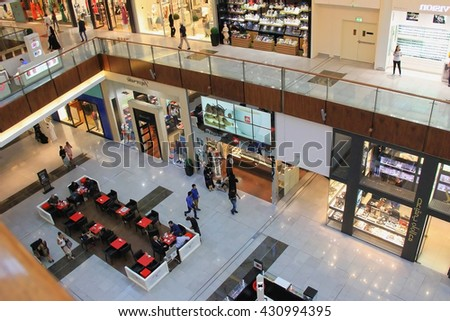 Dubai Mall, a top view of the inside, boutiques and shops, people walking and shopping, United Arab Emirates April 14, 2014, very soft focus, out of focus - stock photo