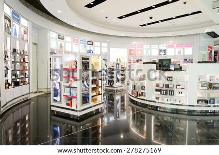 DUBAI - MARCH 10, 2015: Dubai duty-free shopping area interior. Dubai International Airport is the primary airport serving Dubai and is the world's busiest airport by international passenger traffic - stock photo
