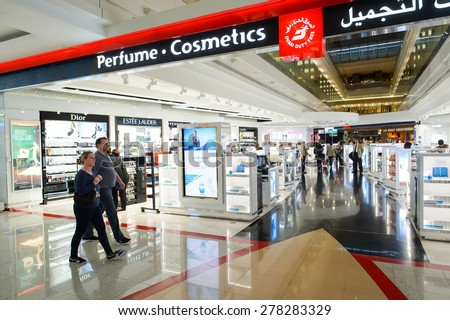 DUBAI - MARCH 10, 2015: The Dubai duty-free shopping area. Dubai International Airport is the primary airport serving Dubai and is the world's busiest airport by international passenger traffic