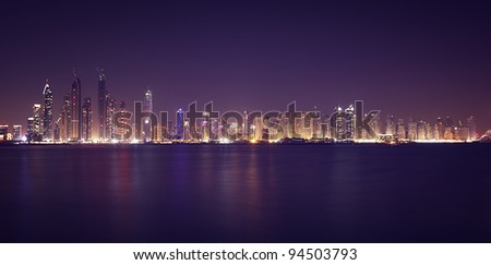 Dubai Marina in the night. Panoramic view from gulf - stock photo