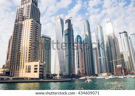 Dubai Marina in UAE, famous district with modern skyscrapers, residential towers - stock photo