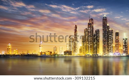 Dubai Marina skyline as seen from Palm Jumeirah - stock photo