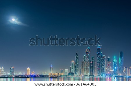 Dubai marina skyscrapers during night hours - stock photo