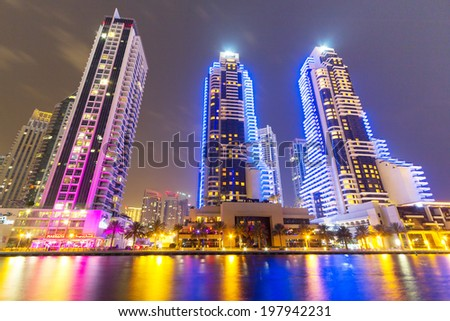 DUBAI MARINA, UAE - MARCH 31: Dubai Marina at night with city lights in Dubai on March 31 2014.  Dubai Marina is an artificial canal city, built along a two mile  stretch of Persian Gulfshoreline. - stock photo